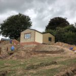 new build in progress with wood and brick effect external walls