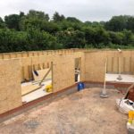new build in progress with external timber frame and walls completed